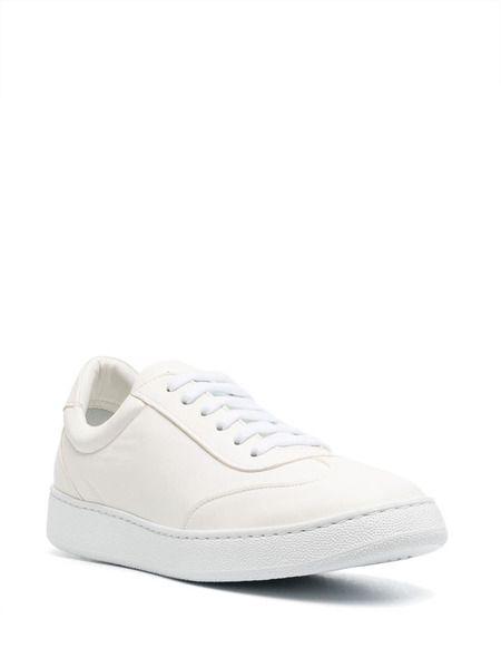 Кожаные кеды на шнуровке белого цвета