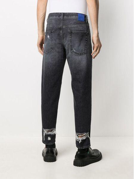 Черные зауженные джинсы с эффектом потертости