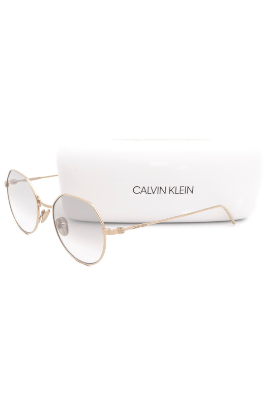 Титановые солнцезащитные очки CK18111S 39173 717 Calvin Klein, фото
